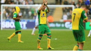 Bradley Johnson claps the fans at the end of the game at the Liberty Stadium.