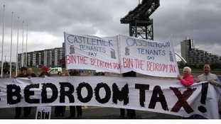 People stage a demonstration over bedroom tax outside the Liberal Democrat conference in Glasgow in September 2013.
