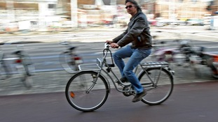 A cyclist in the centre of Amsterdam