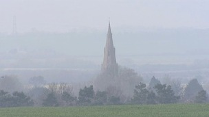 The Church of St Peter & St Paul in Alconbury in Cambridgeshire smothered by smog.