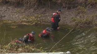 Divers search for the weapon along the River Colne in Colchester.