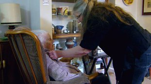 Gill often sleeps on the floor to be near her mum who suffers from dementia
