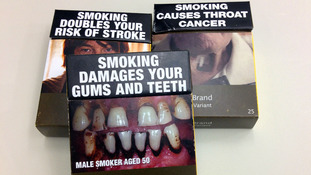 Some examples of standardised cigarette packs used in Australia.