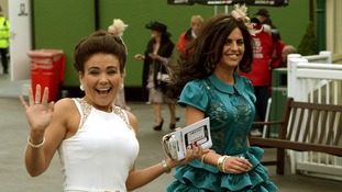Racegoers arrive at Aintree Racecourse for Ladies Day at the Grand National festival.