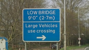 Vehicles over nine feet tall have to use the level crossing.