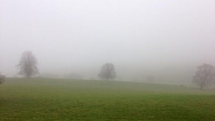 Smog covers Chatsworth House in Derbyshire