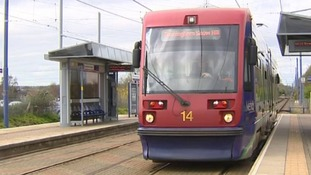 One of the existing Midland Metro trams