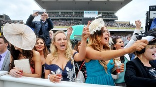 Bright dresses and cheesy hats on show at Ladies' Day