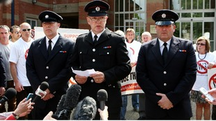 Timothy Woodward (centre) speaks to the media with Paul Simmonds (left) and Adrian Ashley (right) outside court