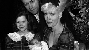 Peaches as a new-born with mother Paula Yates and older sister Fifi Trixibelle.