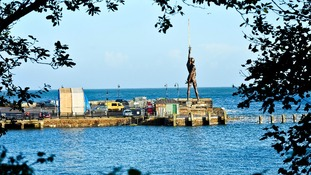 Hirst installed a bronze statue on the harbour of Ilfracombe in Devon - a controversial piece.