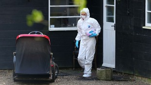 A forensics officer searches the house following the death of 25-year-old Peaches Geldof.