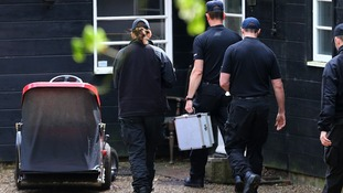 Police officers arrive at the home in Wrotham, Kent.