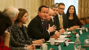 David Cameron sits alongside Mrs Miller at a Cabinet Office.