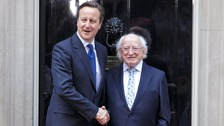Prime Minister David Cameron and Irish President Michael D. Higgins shake hands in Downing Street.