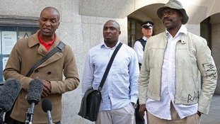 The Tottenham Rights group's Stafford Scott, Mark Braitwaite and Winston Silcott outside the Old Bailey.