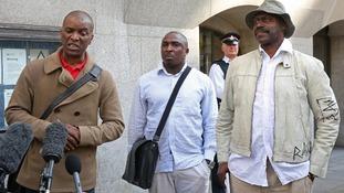 The Tottenham Rights group's Stafford Scott, Mark Braitwaite and Winston Silcott outside the Old Bailey.