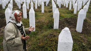 Bosnian Muslim, Suhra Malic, prays at the Memorial Center in Potocari in 2009
