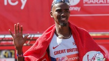 Mo Farah waves after finishing in eighth place at the London Marathon 2014.