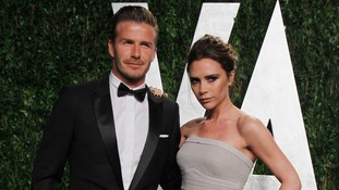 Victoria and David Beckham arrive at the Vanity Fair Oscars party in February 2012.