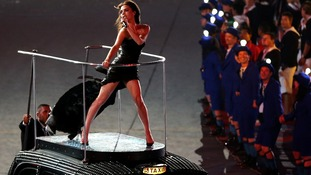 Victoria Beckham takes a cab during the Spice Girls performance at the 2012 London Olympics Closing Ceremony.
