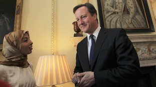 David Cameron speaks to a guest during a reception with campaigners in 10 Downing Street, as part of International Women's Day.