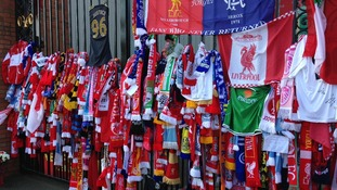 Scarves hanging from stadium gates
