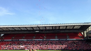Balloons released at Anfield