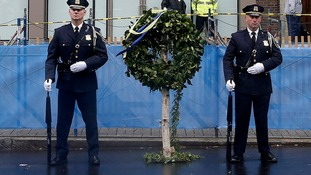 Honour guards stand beside a wreath at the site of the other Boston Marathon bomb blast.