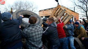 Pro-Russia separatists build a barricade in front of a Ukrainian airbase in Kramatorsk.