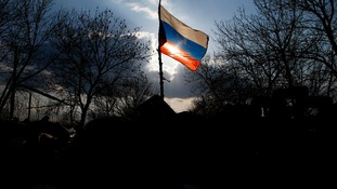 A Russian flag flutters on a barricade in front of Kramatorsk airbase in eastern Ukraine.