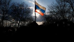 A Russian flag flutters on a barricade in front of Kramatorsk airbase in eastern Ukraine.