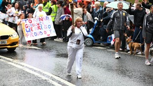 Carol Highton carries the Olympic Flame