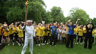 Michael Dooling holds the Olympic Flame in Tatton Park