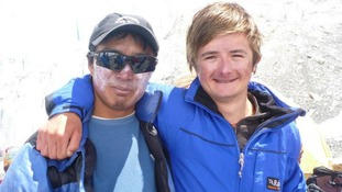 Matthew (right) with one of the team who helped him on the climb.