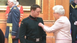 Soldier who lost legs in blast honoured by Queen
