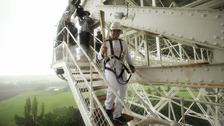 Comedian John Bishop with the torch on the Lovell telescope