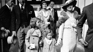 Princess Elizabeth and Princess Margaret with their mother in London in 1934