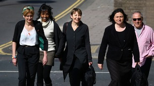 Green MP Caroline Lucas (centre) arrives with co-defendants and supporters at Brighton Magistrates Court in East Sussex