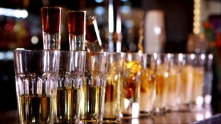 shot glasses lined up on bar