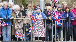 Crowds wait for Queen Elizabeth II and the Duke of Edinburgh outside Blackburn Cathedral