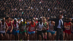 Briton Will Marks won a half-marathon in North Korea's capital Pyongyang, which was opened to foreigners for the first time