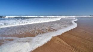 sea rolling onto Warkworth beach