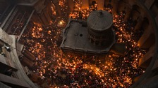 Holy fire ceremony draws thousands to shrine