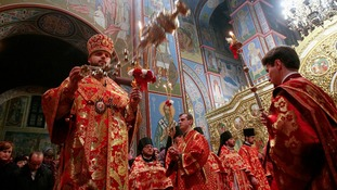 Ukrainian Orthodox priests conduct a holy liturgy during an Orthodox Easter service in Mikhailovsky Cathedral in Kiev.