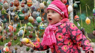 A girl walks past an installation made of Easter eggs in Kiev.
