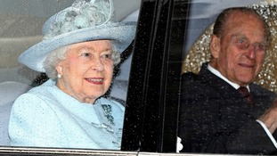 The Queen and the Duke of Edinburgh arrive at Windsor Castle for the Easter Sunday service.