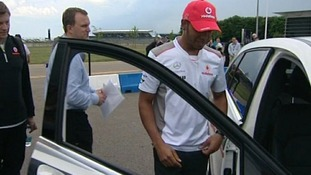 Lewis Hamilton giving safety tips to young drivers at Silverstone