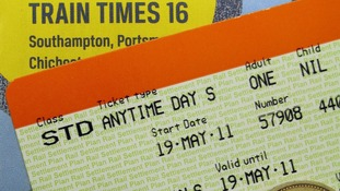 ile photo dated 19/05/11 of a train ticket, money and a railway timetable