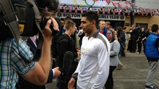 Amir Khan preparing to carry torch in Bolton